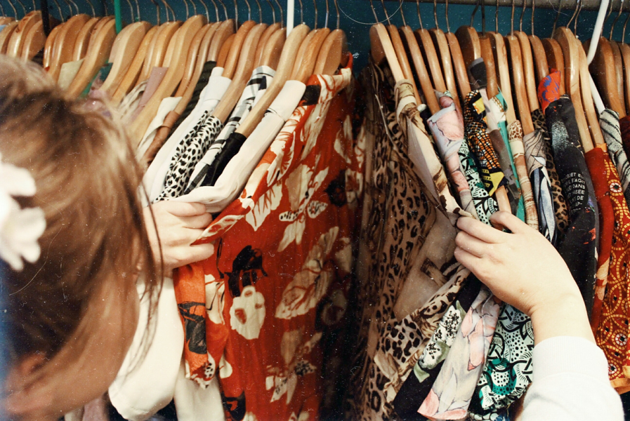 closet of floral dresses creating a sustainable wardrobe